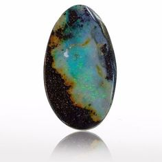 Boulder opal showing sandstone background, makes a powerful oceanic picture stone.