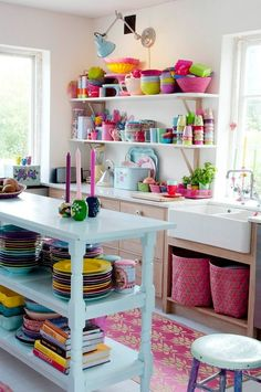 Colorful kitchen. <3 the open shelving, collection of colorful assorted dishes, and the light to to show them off! Great idea!