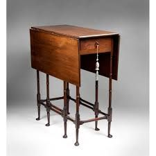 regency one drawer side table with turned legs - love the tassle on the drawer pull (style steal)