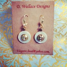 Vintage mother of pearl  button earings.   Find D. Wallace Designs on Facebook and Twitter.