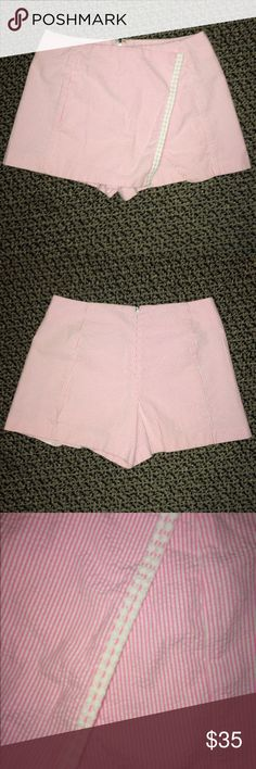 Lilly Pulitzer Pink & Lace Seersucker Skort Size 0 Lilly Pulitzer Pink & White with White Lace Seersucker Skort Size 0. Worn only twice. Perfect condition! Such a cute Skirt!! No longer fits- so selling. Lilly Pulitzer Shorts Skorts