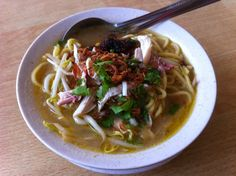 Soto ayam is a yellow #spicy #chicken #soup with lontong or nasi himpit or ketupat and/or vermicelli or noodles. It is a traditional Indonesian soup #deliciously flavored, also served in #Malaysia, #Singapore and Suriname. The aromatic spice paste in this dish is one of the hallmarks of Indonesian cooking.
