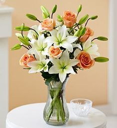 Rose and Lily Bouquet For Wedding, Birthday, Girl Friend, Evening Party and so on. We also can give you the best server at most beautiful flowers Beautiful Flower Arrangements, Silk Flower Arrangements, Flower Centerpieces, Flower Decorations, Beautiful Flowers, Red Bouquet Wedding, Wedding Flowers, Rose And Lily Bouquet, Orange Rosen