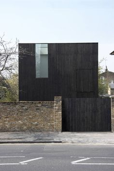 Built by Adjaye Assocates in , United Kingdom with date 2007. Images by Ed Reeve. A three storey house in conservation area of De Beauvoir town in Hackney. The site has been excavated to basement lev...