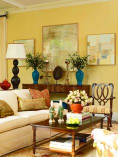 beautiful yellow living room....love the symmetry of the vases and candlesticks