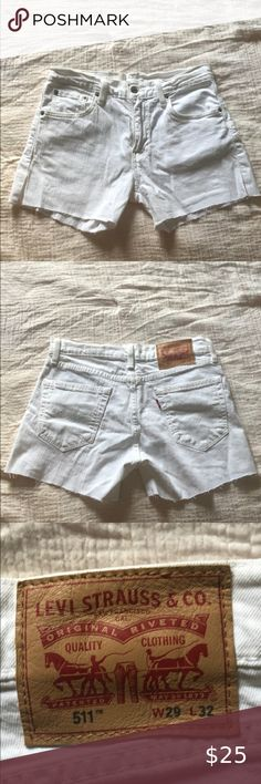 White Levi Jean Shorts (511) Never worn white Levi's with distressed hems on the bottom. They also have a split on both sides of the shorts. The width is 29, and the length is 32. Levi's Shorts Jean Shorts