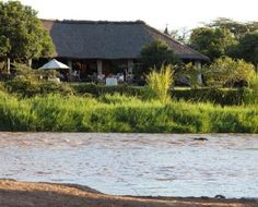 Karen Blixen Camp in the Masai Mara is set on the bank of the Mara River the location is spectacular, with the great Mara plains behind the camp and the impressive escarpment and Mara River in front. Throughout the day, zebras, elephants and hippos come to drink from the river. 