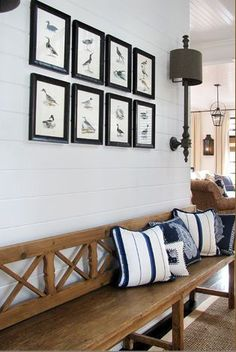 Warm wood bench + white planks + sconces + curated birds of a feather | Designer Berner Sutphins; TG interiors: