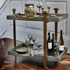 The stylish Glaston Bar Cart in grey is a gorgeous and modern addition to a contemporary home. Made from iron with antique brass finish and a faux Shagreen top the Glaston range is a fantastic and timeless choice.