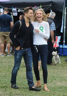 Smitten: Rachel Riley, 30, and her beau Russian Pasha Kovalev, 36, looked madly in love as they attended the PupAid Anti Puppy Farming Event in Primrose Hill in London