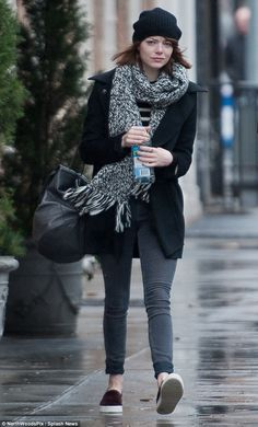 Bundle up, 'cause Baby, it's cold outside! Emma Stone went for a walk through New York City on a wet wintry Wednesday afternoon