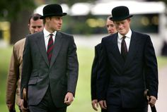William and Harry looking dapper in the rain in London in 2007. The bowler hats really make this photo