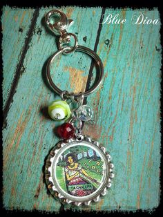 """Items similar to Vintage Mexican Loteria """"La Chalupa"""". Bottle Cap Keychain, Purse Charm, bag Charm on Etsy Mexican Birthday Parties, Loteria Cards, Vendor Booth, Mexican Jewelry, Sugar Art, Bead Art, Mayo, Make And Sell, Key Rings"""