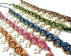 This beautiful anklet features brass dangle findings which drape your ankle. Chain Color Options: Green Red Purple ............................................................. One Size Fits Most. Adjustable tie closure.