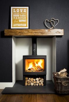 Wood Burner In Grey Room With Wooden Mantle Living Room