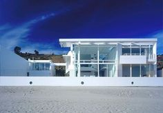 modern beach mansions | architecture of modern beach house with a white color