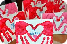 Handprints creating a heart for valentine saying...