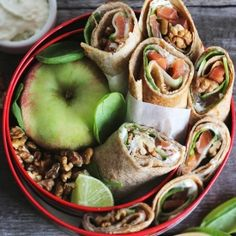 Sandwich wraps with smoked salmon, spinach, walnuts and cottage cheese dip.
