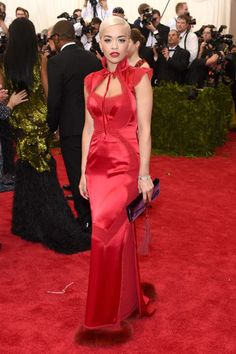 Rita Ora...She has the look I want to suck your blood...The dress is beautiful the clutch doesnt match...Best Dressed at the 2015 Met Gala