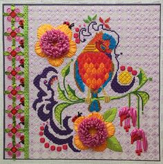 It's not your Grandmother's Needlepoint: bird and flowers, designer unknown