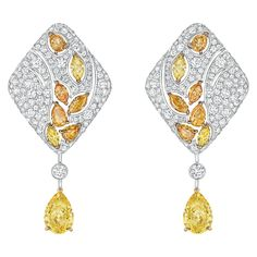 Impression de Blé #Earrings from #LesBlesDeChanel - #Chanel - #FineJewelry collection in 8K white and yellow gold set with 2 #PearCut fancy/intense #YellowDiamonds (5 cts),14 #FancyCut multicoloured diamonds (3.4 cts) and 398 #BrilliantCut - #Diamonds (4.5 cts) - July 2016