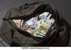 A bag full of large billed Euro banknotes View Large Photo Image