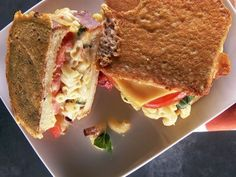 Parmesan-Crusted Grilled Cheese stuffed with bacon mac n cheese and tomatoes