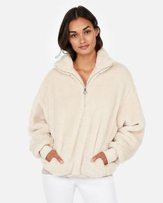 581d1315d1c8 You haven t felt comfort like this extra plush fleece sweatshirt. Oversized  with hand pockets and a high neckline, it s chic and cool enough to wear  out.