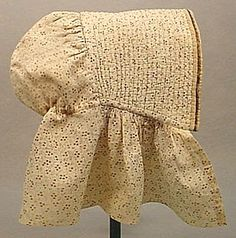 circa 1860 little girl's brown on white calico printed cotton bonnet. A fully corded brim bound in silk satin with evidence of silk chin ties