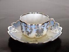 Demitasse tea cup and saucer. antique porcelain. Limoges  silver overlay