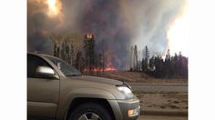 Here are the latest images from a large wildfire that displaced tens of thousands in Alberta, Canada.