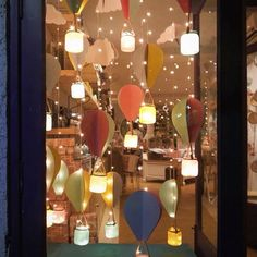 Good night glowbugs! Closing time at shahpurjat store. Our April windows - hot air balloons in spring colors  #windowdisplay #hotairballoons #DIY #springtime #springcolors #fairylights #decorideas #decor #homedecor