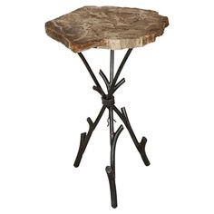 Masterfully crafted of 1,000-year-old petrified wood, this striking side table brings artful intrigue to your living room or den decor.