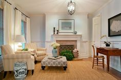Light blue  walls, light yellow drapes and in the furniture.