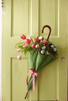 An umbrella is a clever way to group flowers and greenery together.  Simply turn the umbrella upside down and tie it around the middle. Fill with flowers to form a bouquet and hang or attach the umbrella to the door for a seasonal door decoration.