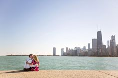 Fullerton Beach Chicago Skyline Engagement Photography. With over 18 miles of Lakefront, there's no wonder why Chicago has some of the best beaches in the country.