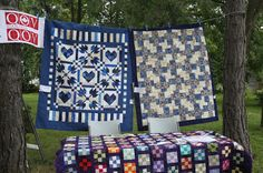 """Pioneer Village Quilt Show 2013  The pattern for the blue quilt with hearts and maple leaves is called """"Canadian Valour"""", by Pat Lore and is available on the QOV website. http://www.quiltsofvalour.ca/"""