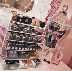 Makeup vanity organization, clear box of (stackable?) shelves/drawers. Compact but holds a lot