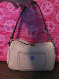This stylish bag from Coach is the     perfect blend of fashion and function    COACH    WOMENS WHITE      PEBBLED LEATHER    SHOULDER HANDBAG    MINT CONDITON    FOR PREOWNED    AUTHENTIC    5 IN HEIGHT    9 IN LENGTH    8.5 IN STRAP DROP    4.5 IN DEEP    WHITE LEATHER FOB    SUPER CUTE & STYLISH    WONDERFUL ADDITION    TO YOUR WARDROBE