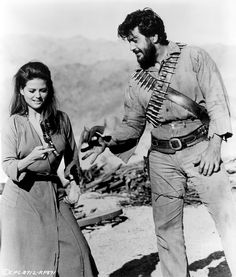 THE PROFESSIONALS - Claudia Cardinale tries her hand at gun handling