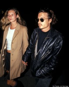 Kate Moss And Johnny Depp show that a camel coat and a leather jacket go together like peanut butter and jelly.