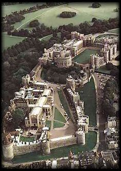 Aerial view of Windsor is the oldest, longest inhabited castle in the world. Construction began in the 11th century by William the Conqueror. It has been used as a residence by monarchs since Henry I.  Berkshire, ENGLAND