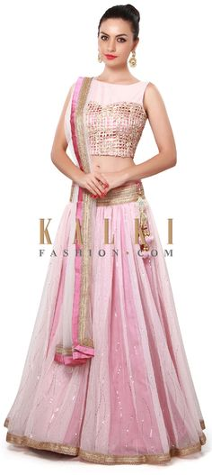 Buy Online from the link below. We ship worldwide (Free Shipping over US$100). Product SKU - 302575. Product Price - $489.00. Product link - http://www.kalkifashion.com/pink-lehenga-enhanced-in-lace-embroidery-only-on-kalki.html