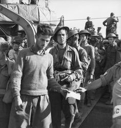 Australian soldiers landing in Egypt after being evacuated from Greece.  The evacuation took place between April and May 1941.  There was heavy casualties during this campaign with 320 killed and 2,030 captured