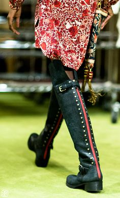 The rear view: a red stripe and studs climb the back of these distressed-leather riding boots #toryburchfall14 #nyfw