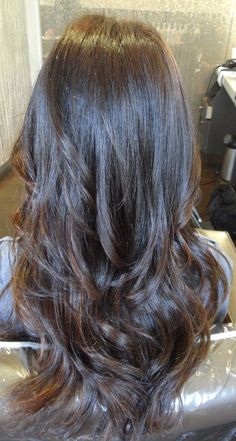 Long layered hair. Blow dry using large round brush to smooth and naturally curl ends.