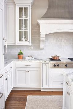 glossy white subway tile, white kitchen, traditional home, range,