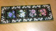 Mini carpet embroidered with floral designs