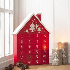 Red Advent HouseA reusable Christmas Advent calendar really adds to the excitement on the build up to Christmas both for the giver and the receiver. This beautiful red wooden advent house with white hand-finished detailing is a lovely decoration for y Advent Calander, Diy Advent Calendar, Nordic Christmas, Noel Christmas, Modern Christmas, Handmade Christmas, Christmas Stockings, Wooden House Advent Calendar, Calendar Home