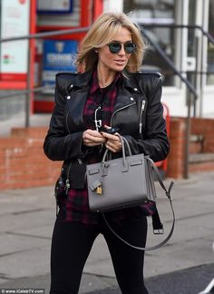 Blonde bombshell:Looking in good spirits on the outing, the 34-year-old WAG radiated with...